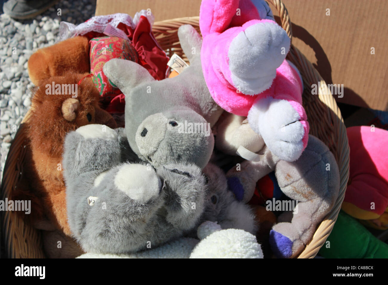 Secondhand plush toys on a flea market. - Stock Image