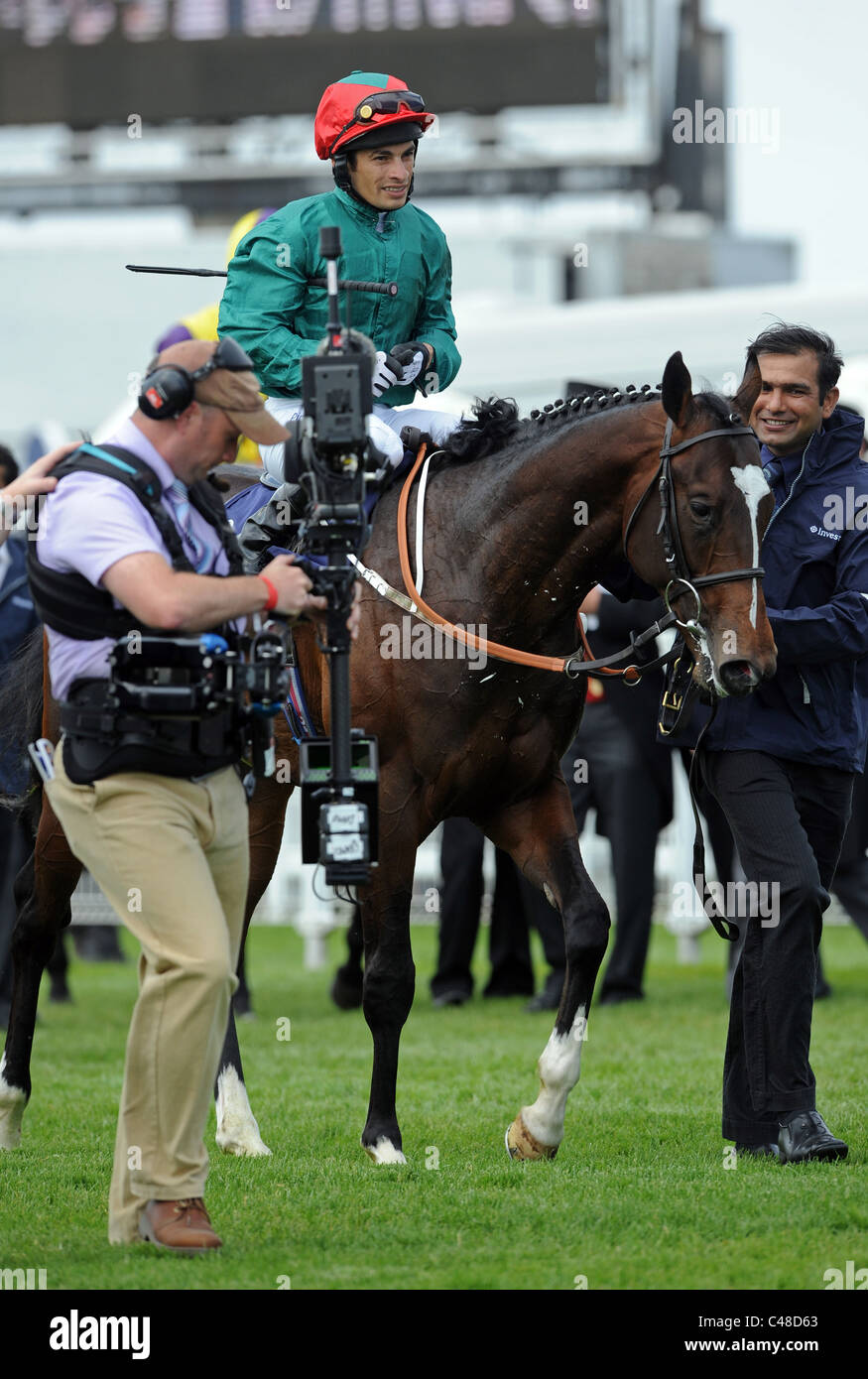 Silvestre De Sousa riding Fulbright celebrates winning the Investec Woodcote Stakes at the 2011 Investec Derby Meeting - Stock Image