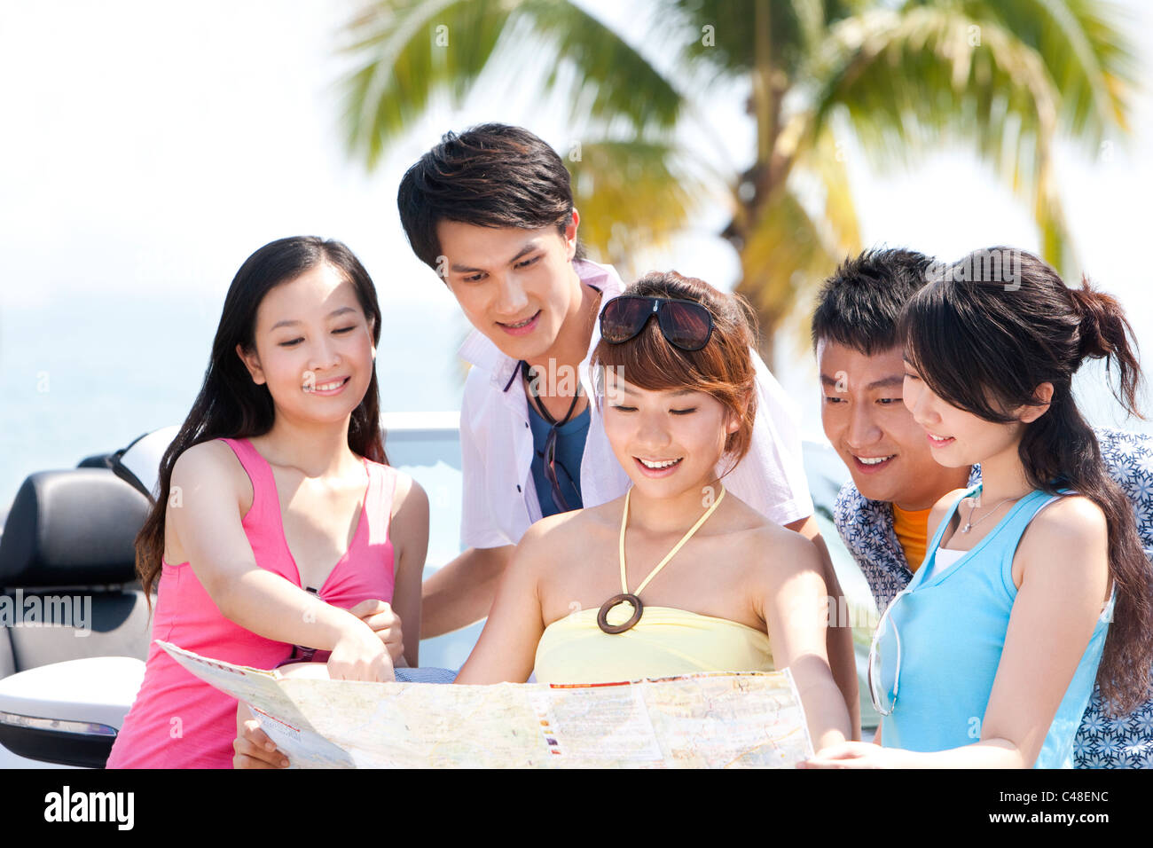 Friends Looking at a Map - Stock Image