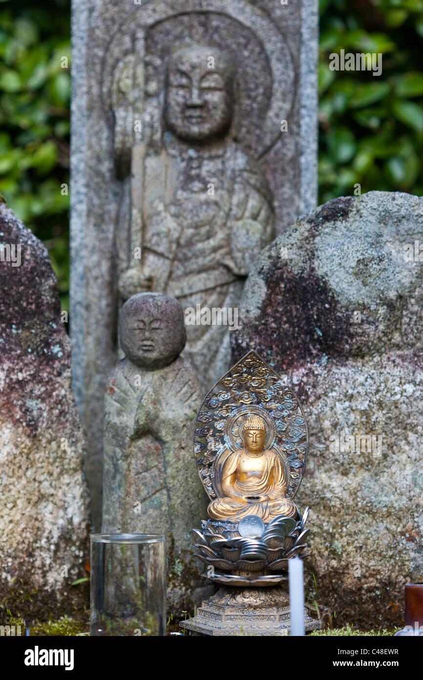 Japan, Kyoto, Nanzen Temple, Saisho In. Garden, Large Stone Jizo Statues,  Small Golden Jizo Bosatsu Statue In Front. Contrast.