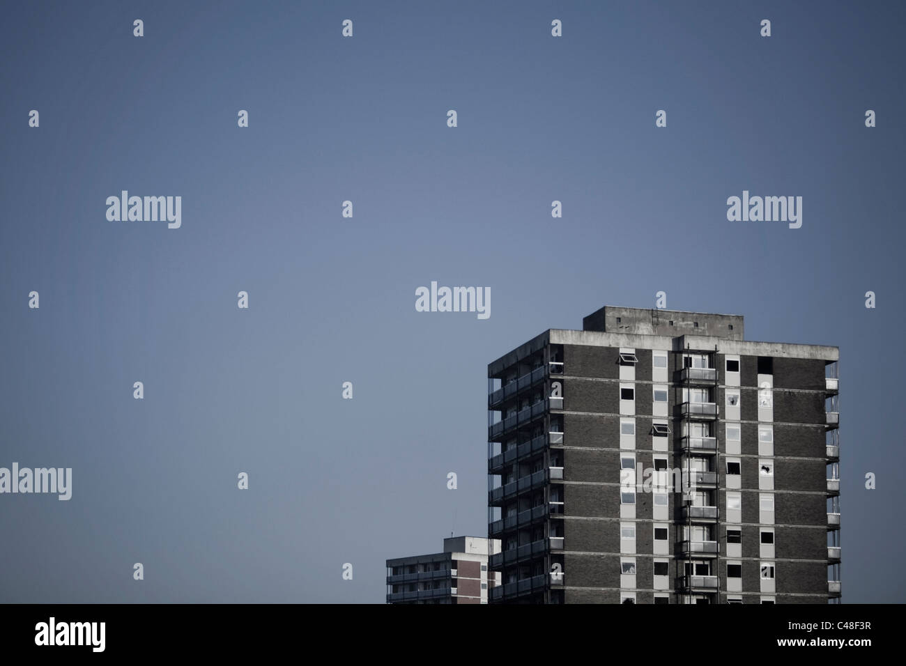 Two vacant tower blocks stand side-by-side on the border of Ancoats and Miles Platting in Manchester. - Stock Image