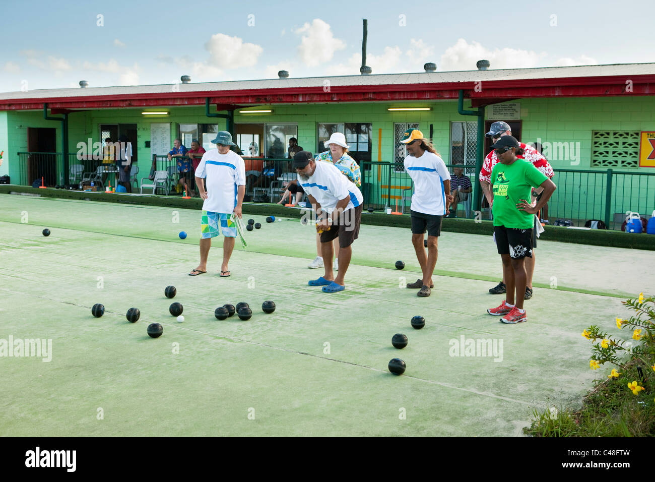 Men playing lawn bowls at the Thursday Island Bowls club. Thursday Island, Torres Strait Islands, Queensland, Australia - Stock Image