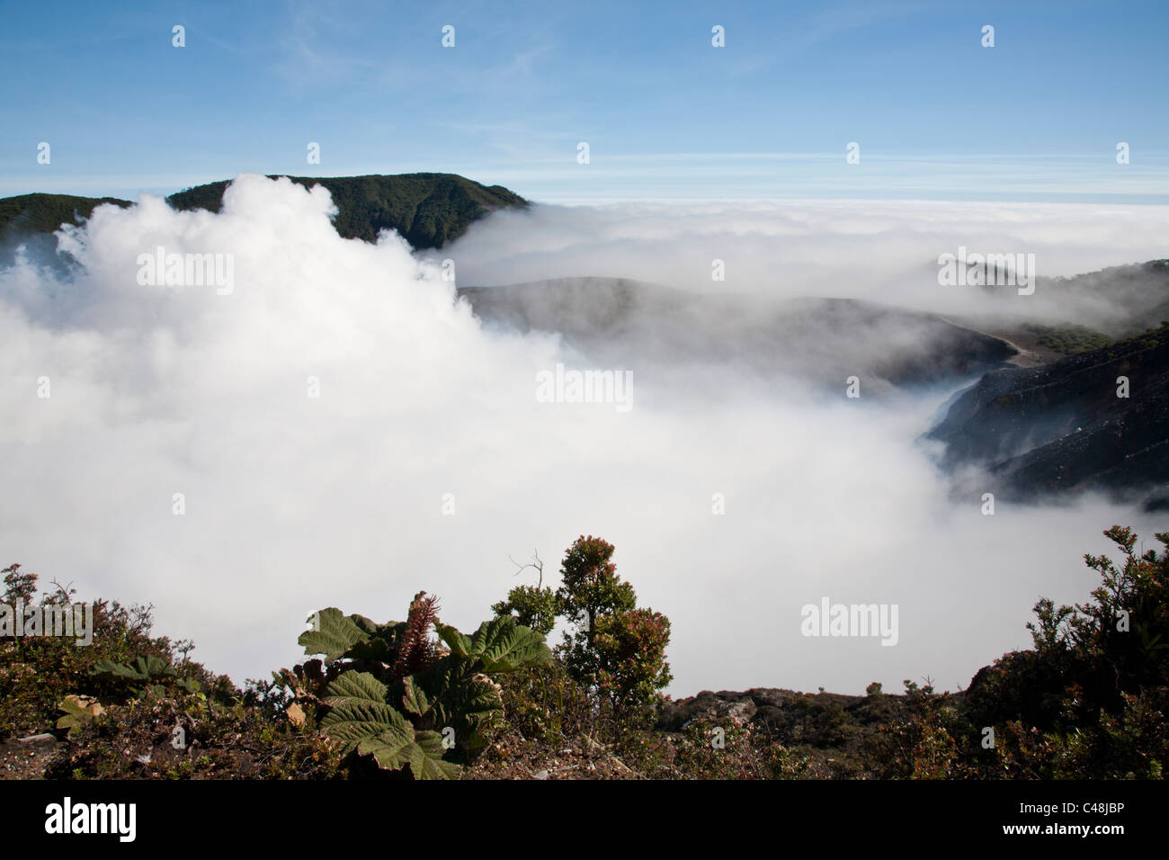 By clouds limited view of the Poas volcano crater. Near San Jose, Costa Rica. - Stock Image