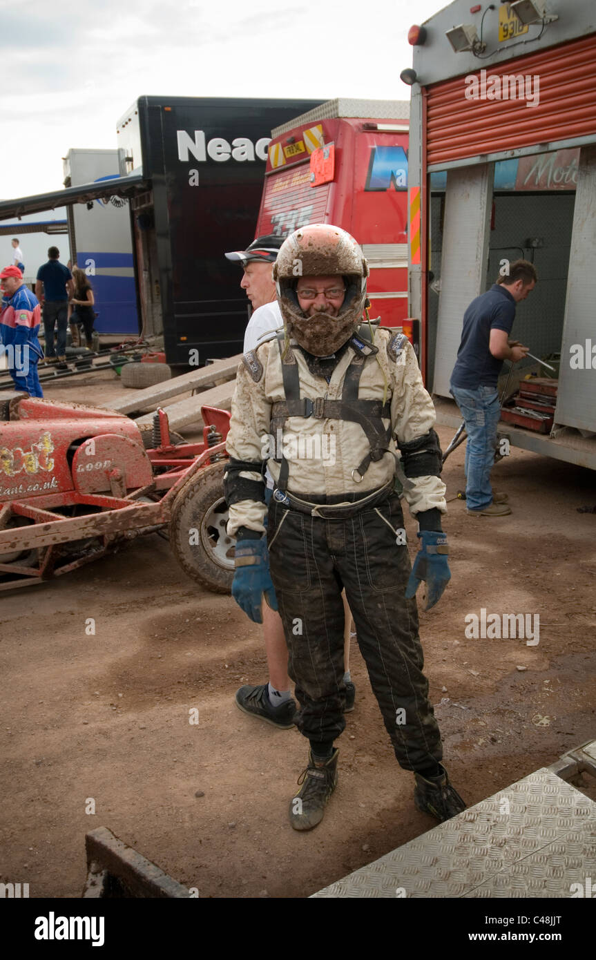 stock car racing driver wearing safety equipment - Stock Image