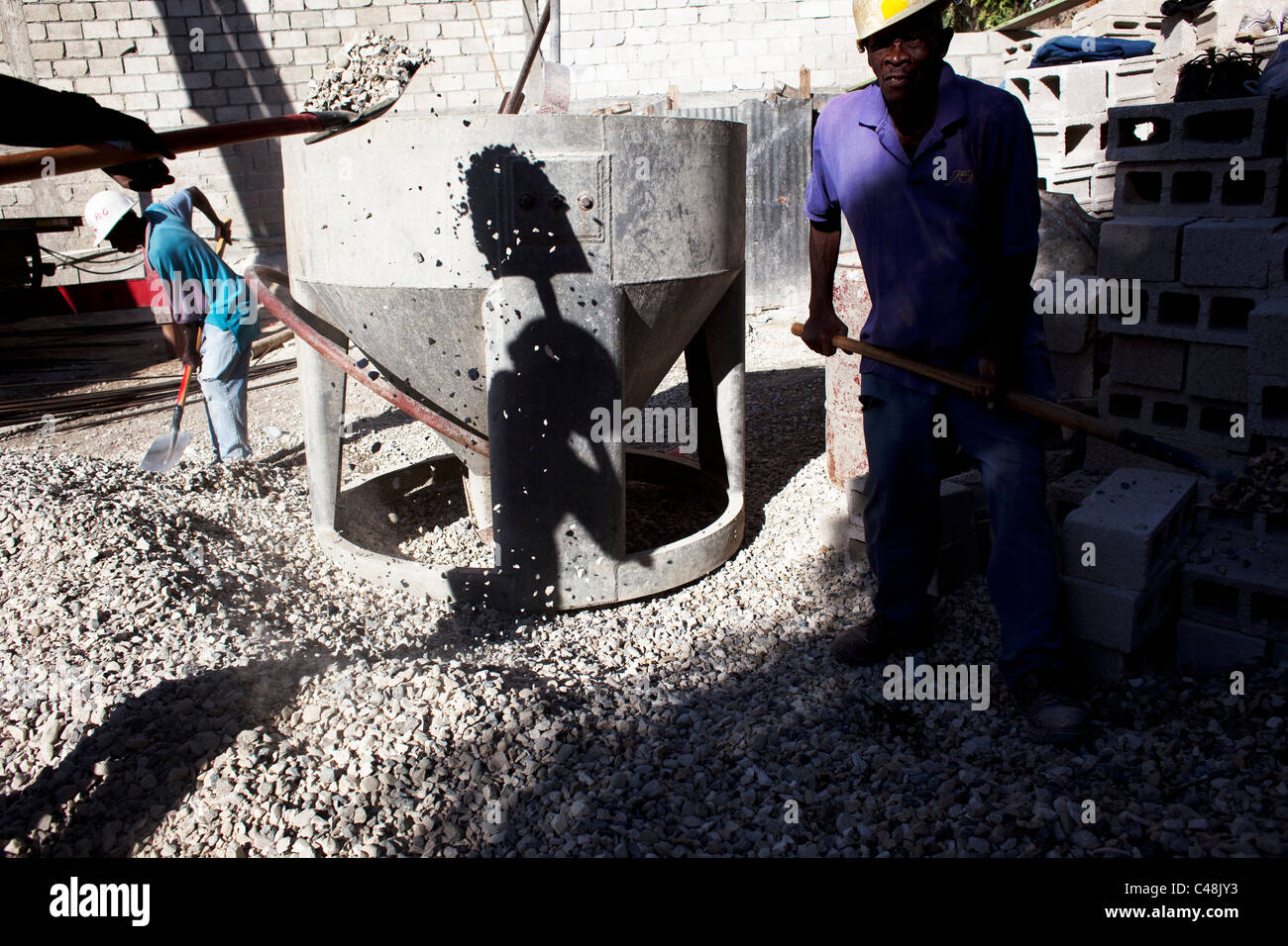 Workers with shovels doing reconstructions labor. - Stock Image