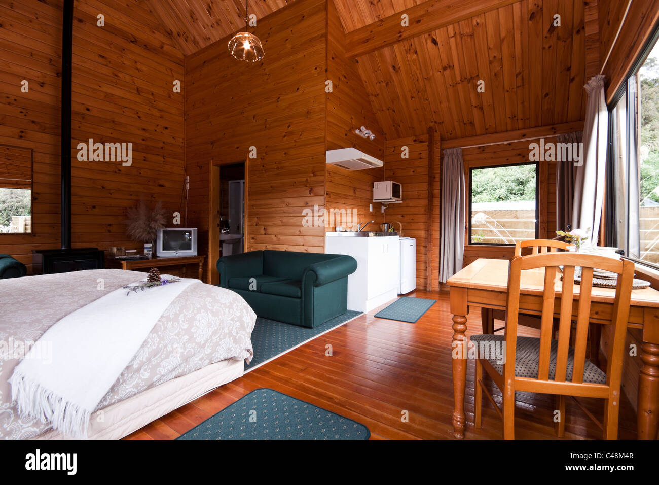 Nice warm interior of mountain lodge apartment. Fox Glacier Lodge, Fox Glacier, West Coast, South Island, New Zealand. - Stock Image