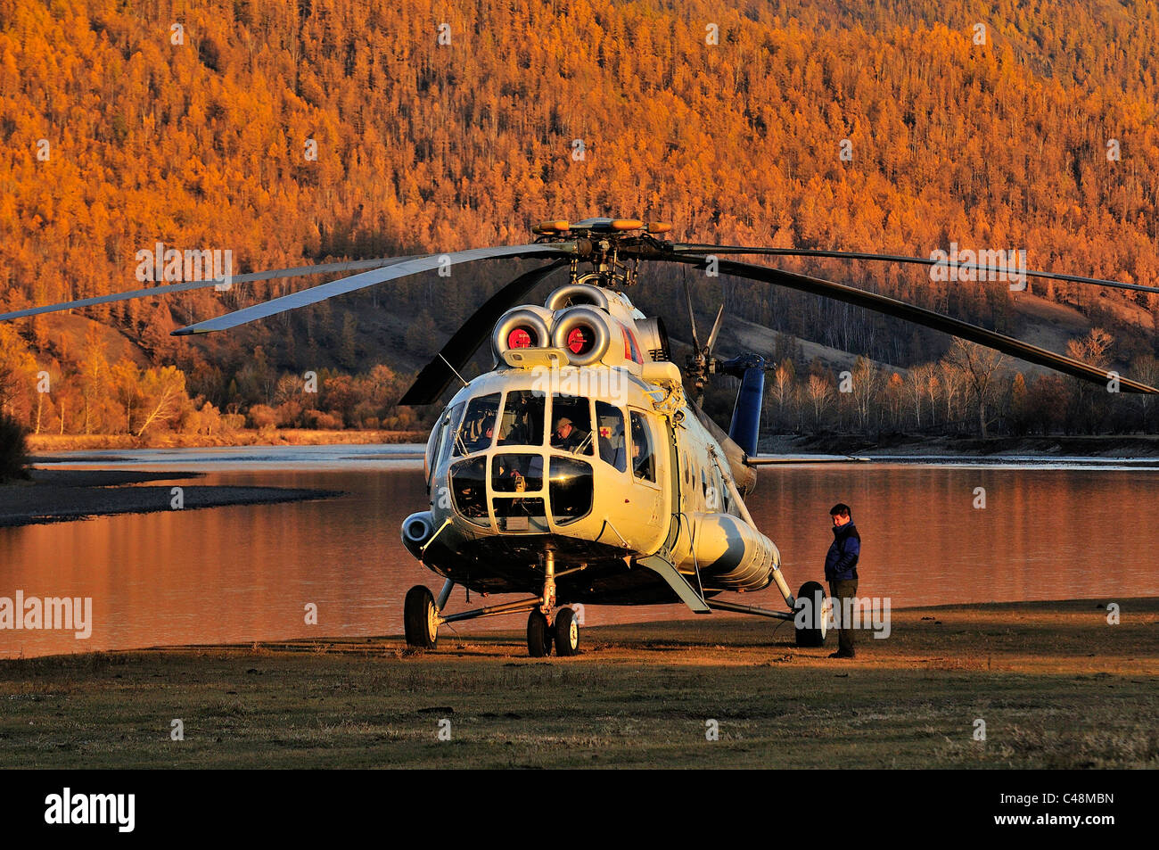 Helicopter delivers guests to fly fishing camp in Mongolia. - Stock Image
