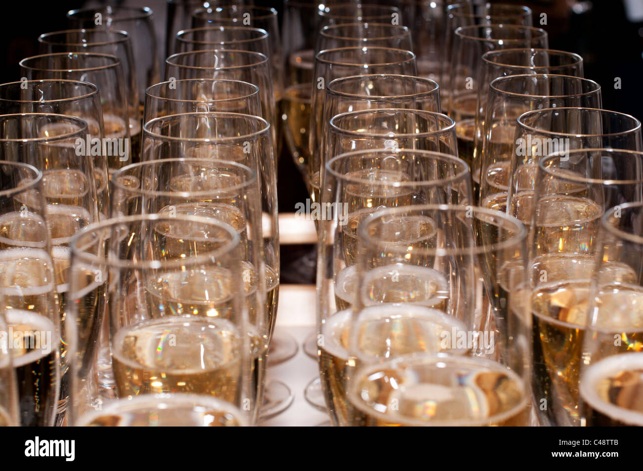 Champagne flute glasses filled with Champagne - Stock Image