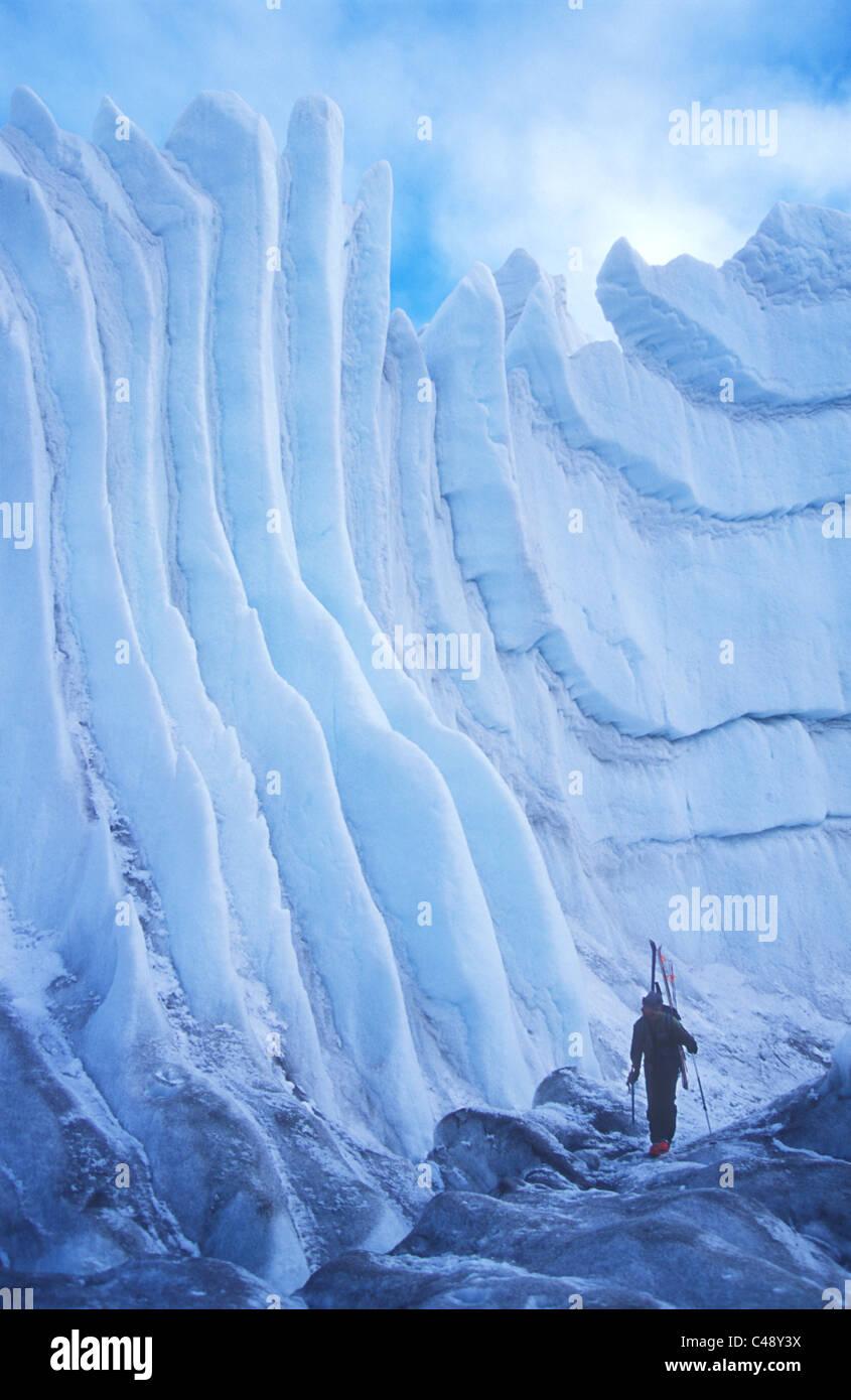 Man hiking up the Central Rongbuk Glacier towards Mount Everest - Stock Image