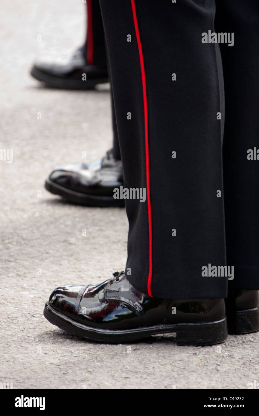 Close-up from the side of the highly polished boots of Scots guardsmen. - Stock Image