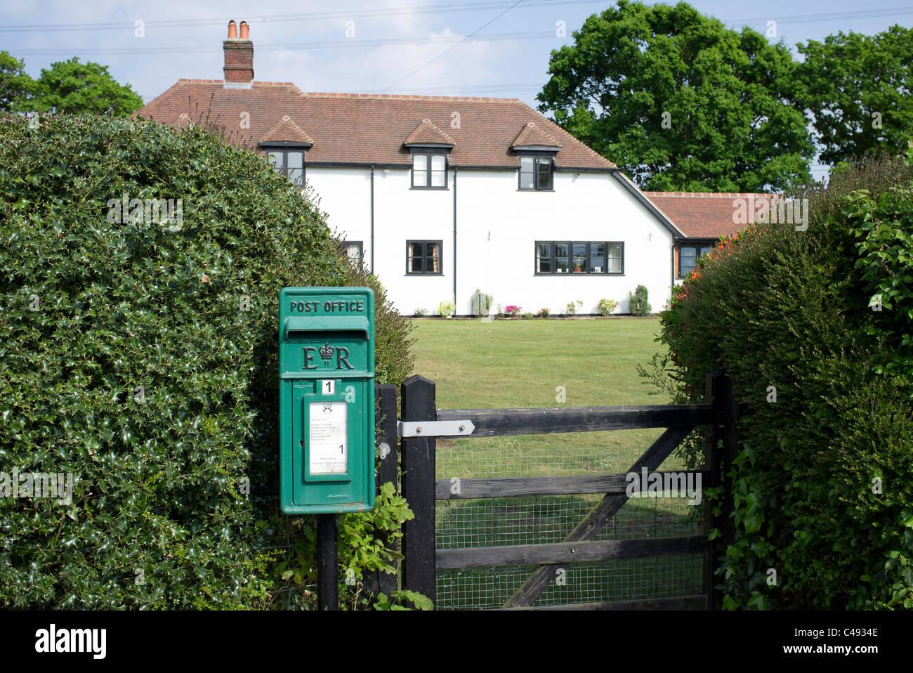 green post box outside beam cottage, Warsash, Hampshire, UK - Stock Image