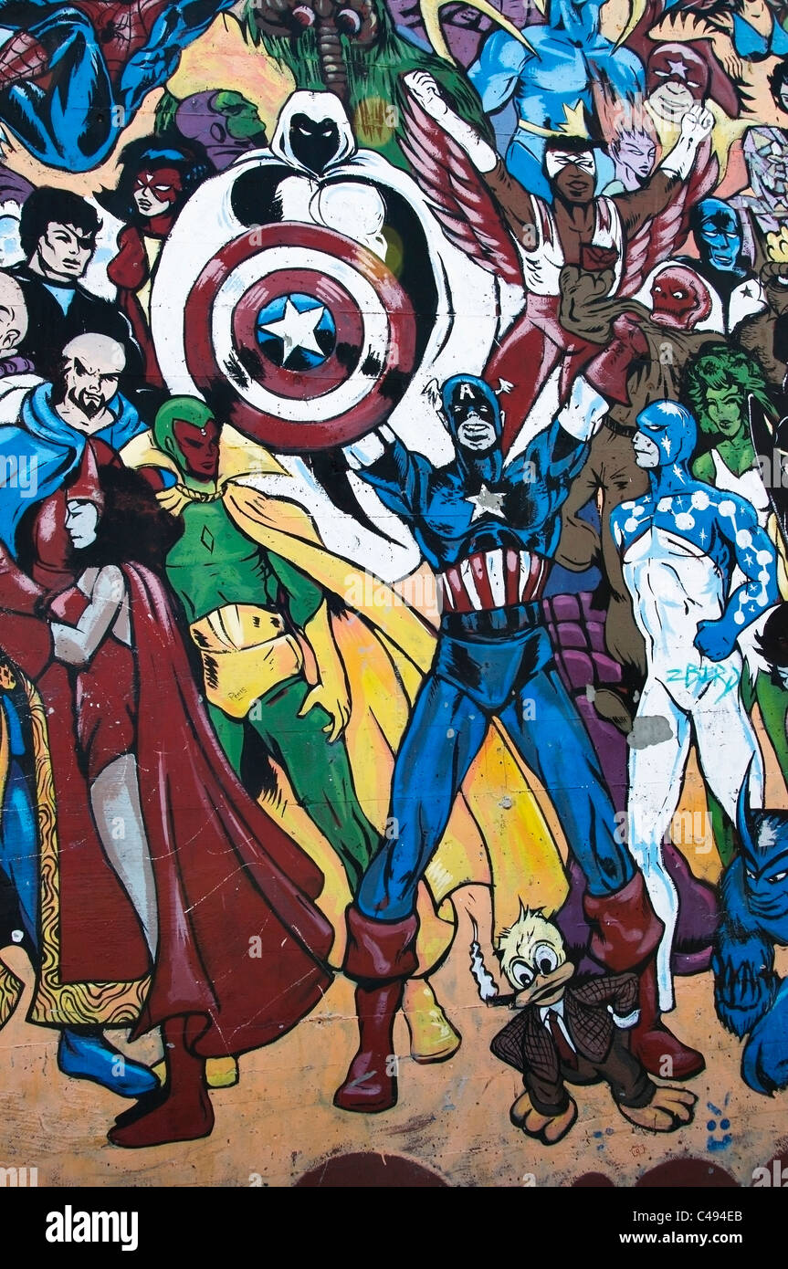 Vertical section of a wall  painted with superhero graffiti in a downtown alley in Olympia, Washington. - Stock Image