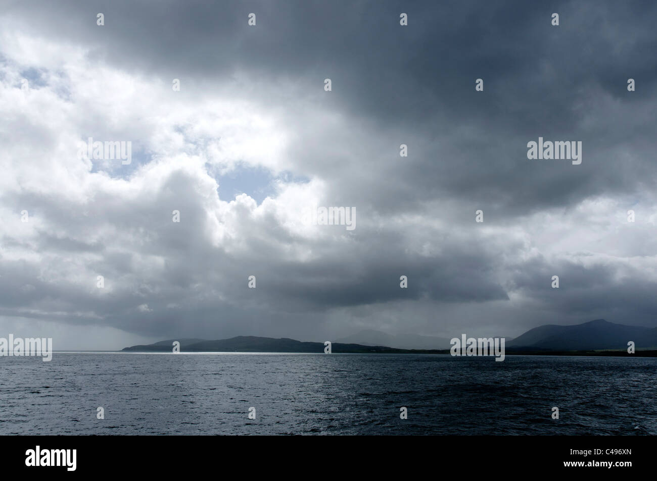 A cloudy and showery afternoon on the Sound of Mull. - Stock Image
