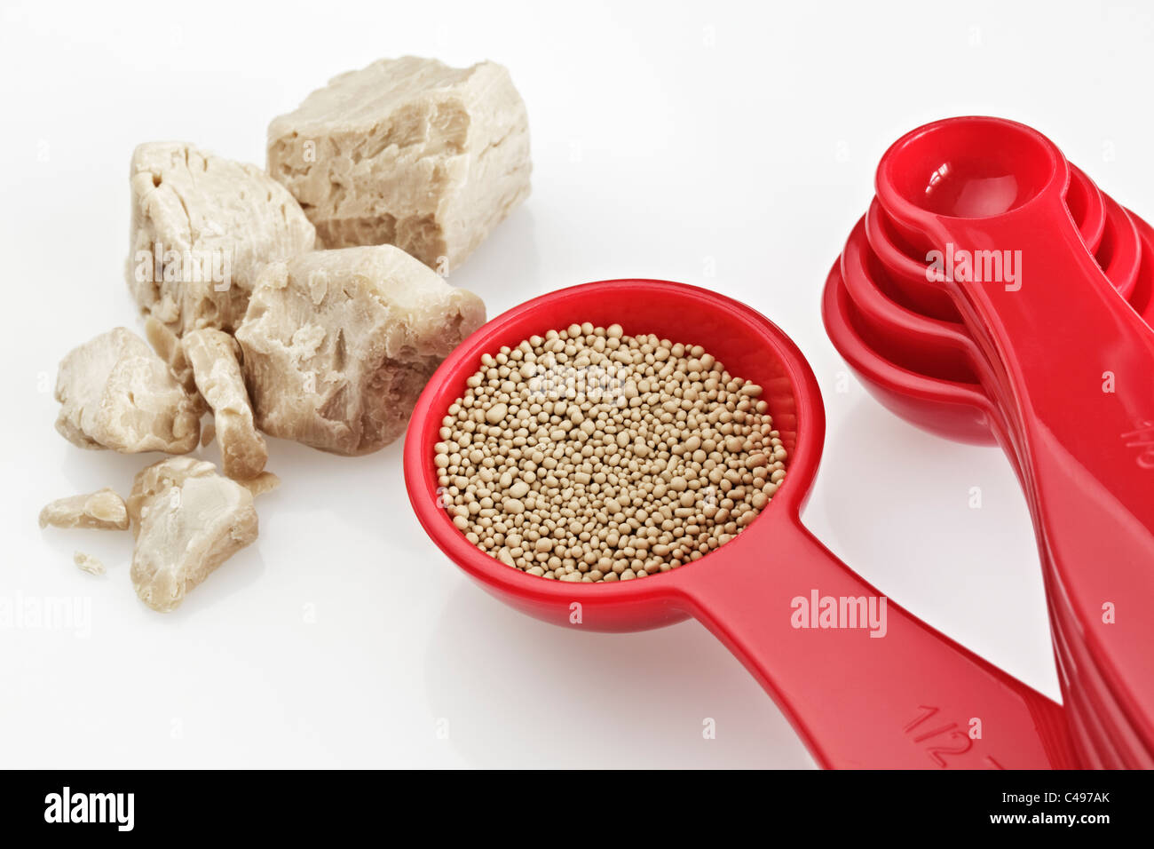 Fresh Yeast and  a Spoon of Dried Yeast - Stock Image