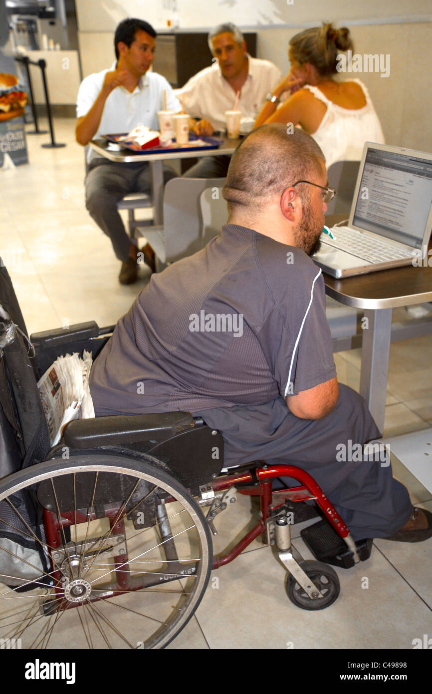 Quadriplegic Argentine man using a computer by typing with his mouth in Buenos Aires, Argentina. - Stock Image