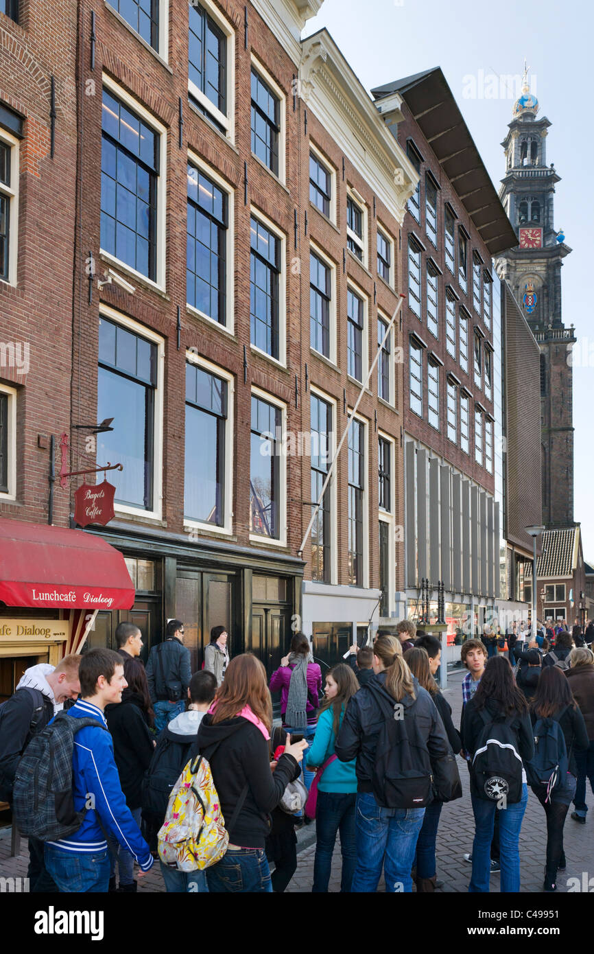 Tourists in front of the Ann Frank House on Prinsengracht with tower of Westerkerk (Westertoren) behind,  Amsterdam, Stock Photo