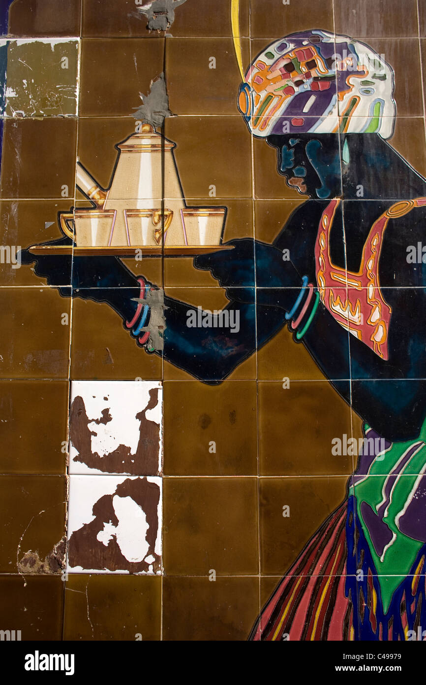 Decorative tiles of a black woman selling coffee decorate a wall in Merida, Badajoz province, Extremadura region, - Stock Image