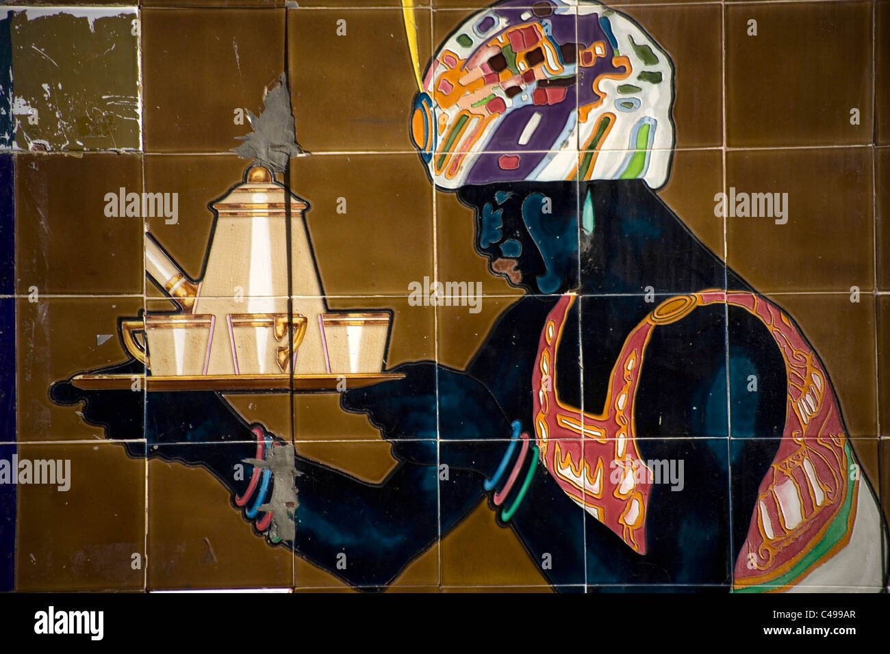 Decorative tiles of a black woman serving coffee decorate a wall in Merida, Badajoz province, Extremadura region, - Stock Image