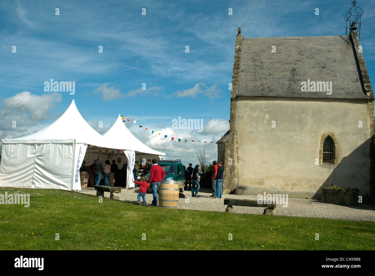 In the Gers village of Lupiac a glimpse of the annual wine fete - Stock Image