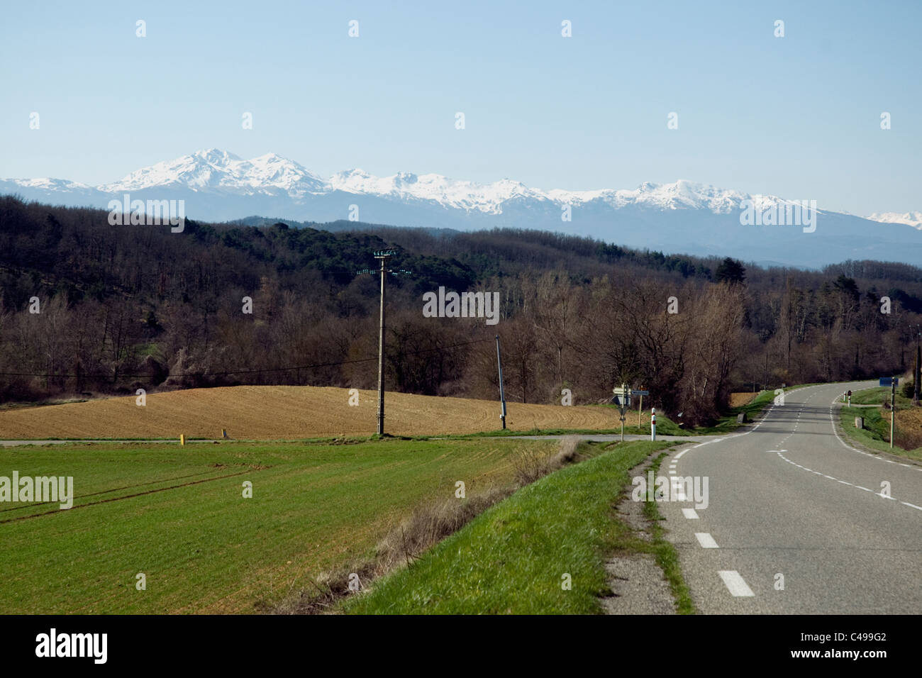 Well-maintained roads--this one in the Ariège with a view of the Pyrenees--are one of the pleasures of driving - Stock Image
