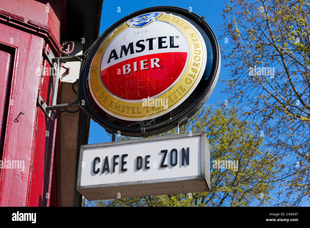 Sign for Amstel beer outside a bar in the red light district of Amsterdam, Netherlands - Stock Image