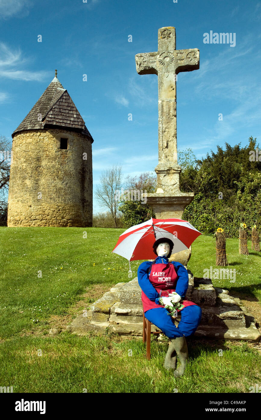 A jolly stuffed figure on the outskirts of Lupiac village promotes Saint Mont wines during a weekend fete - Stock Image