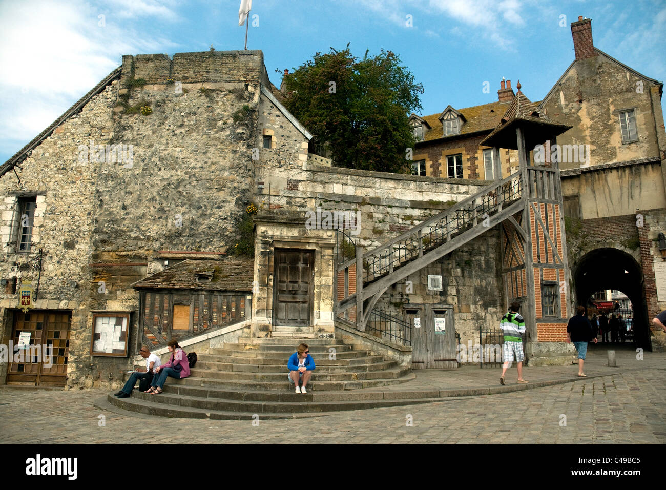 A characterful semi-ruin beside the charming and elegant inner port, Vieux Bassin, in Honfleur, Normandy, draws - Stock Image