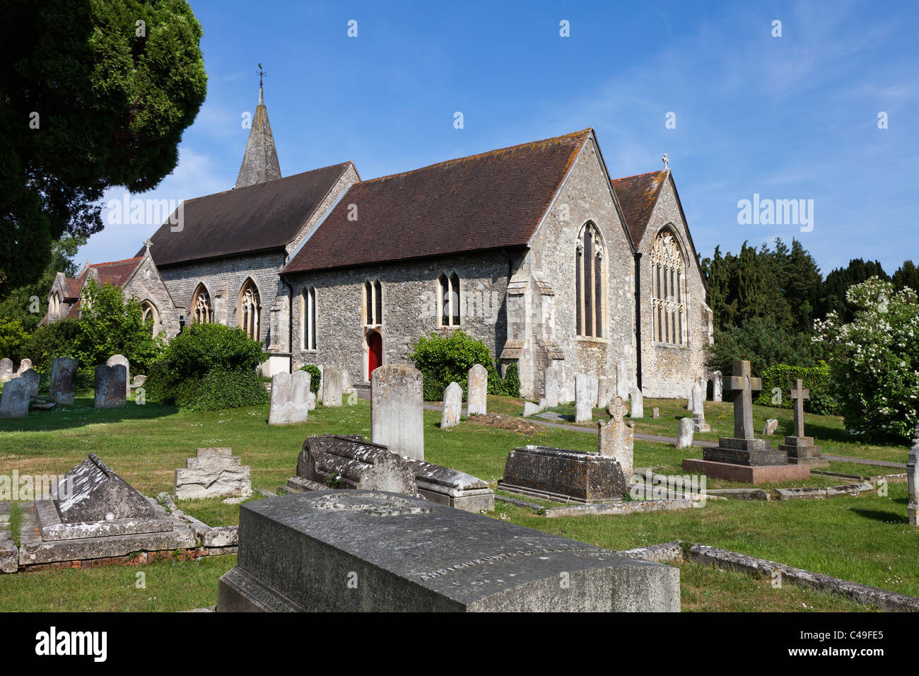 St Peter's Church Titchfield Wilfrid's Saxon Church Hampshire graves graveyard grave stone English England Old - Stock Image
