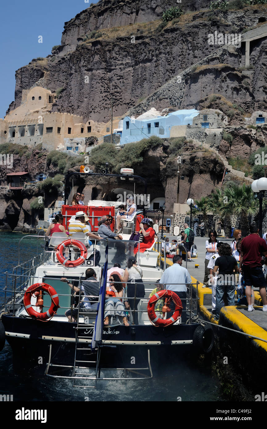 Santorini island, Greece, Tourists going on board on a boat - Stock Image