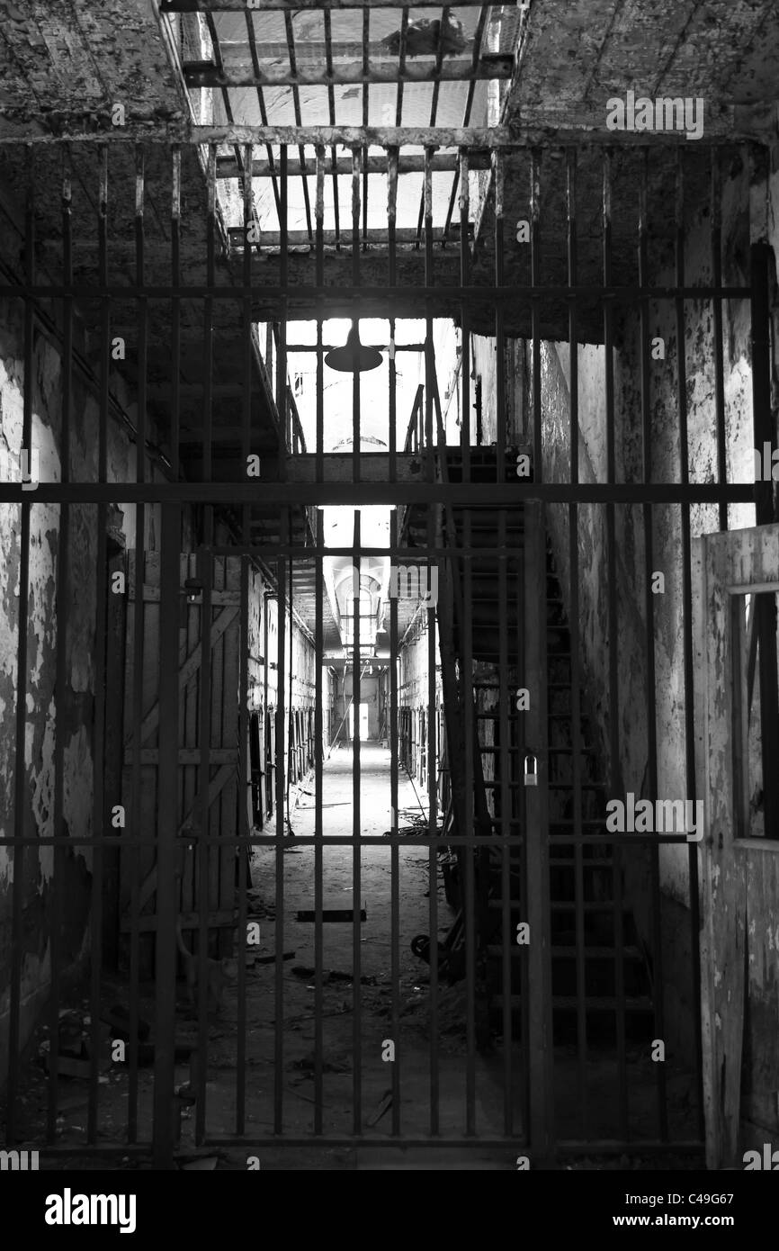 Bars block tourists from walking into one of cellblocks at Eastern State Penitentiary. - Stock Image