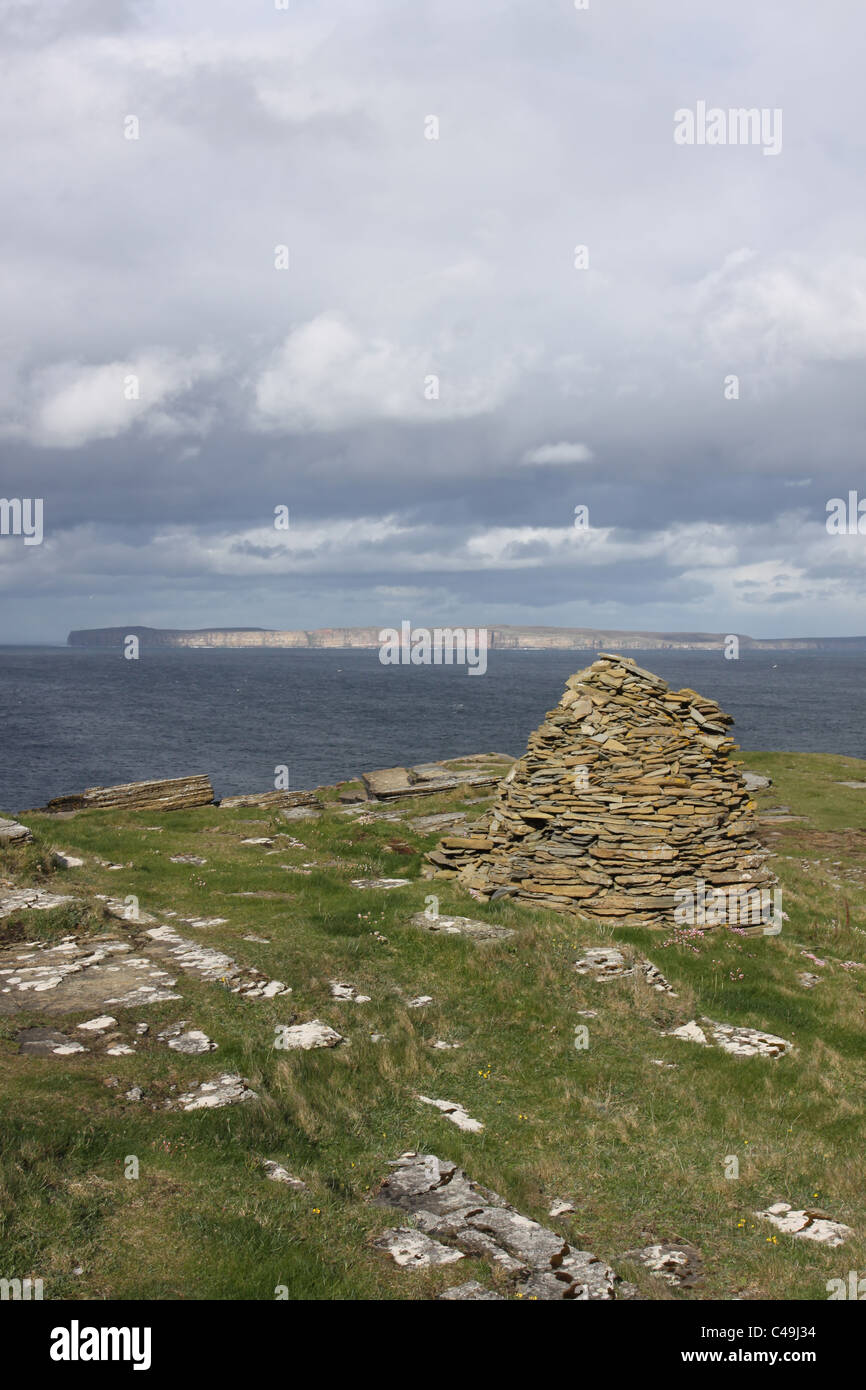 Cairn on Holborn Head with distant Dunnet Head Caithness Scotland May 2011 - Stock Image
