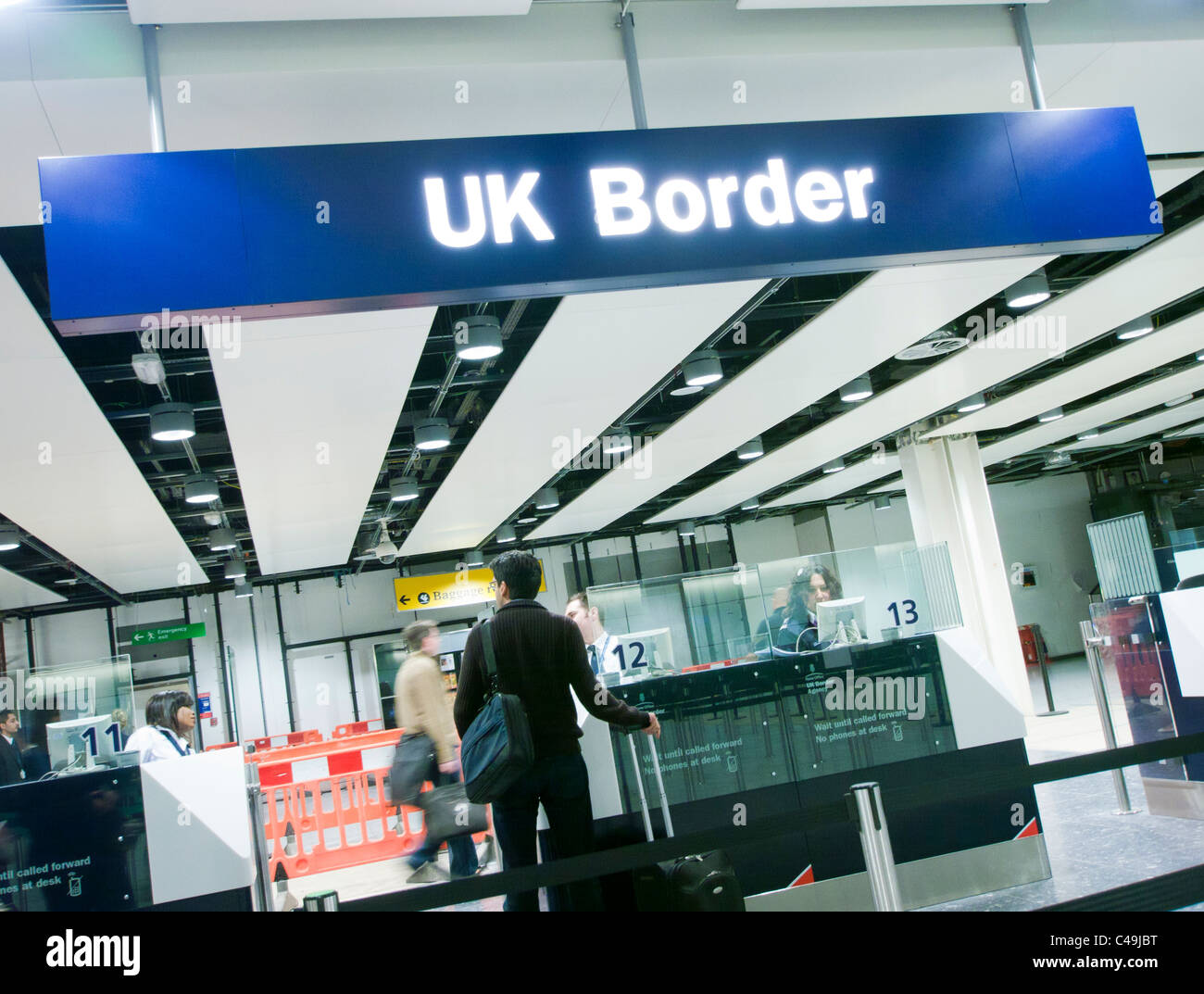 Immigration at UK Border control at an airport in Britain - Stock Image