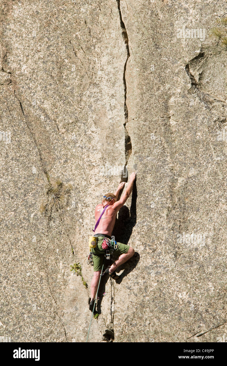 Rock climber climbing a 5.11c crack across from Cliffside Camp on the Middle Fork of the Salmon River ID - Stock Image