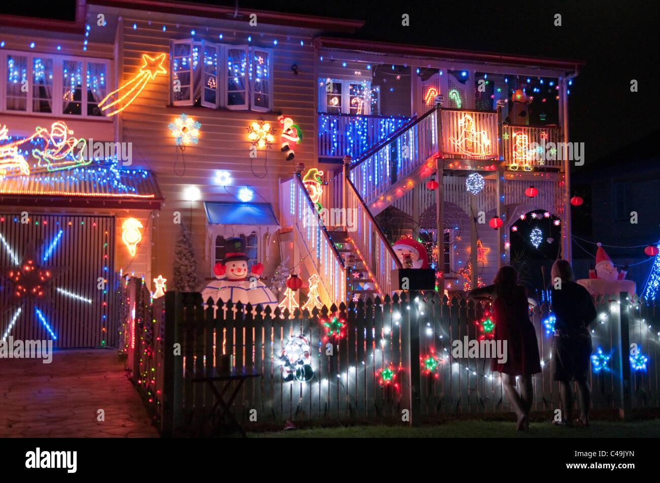 Christmas Lights Decorating A House Brisbane Queensland Australia Stock Photo Alamy