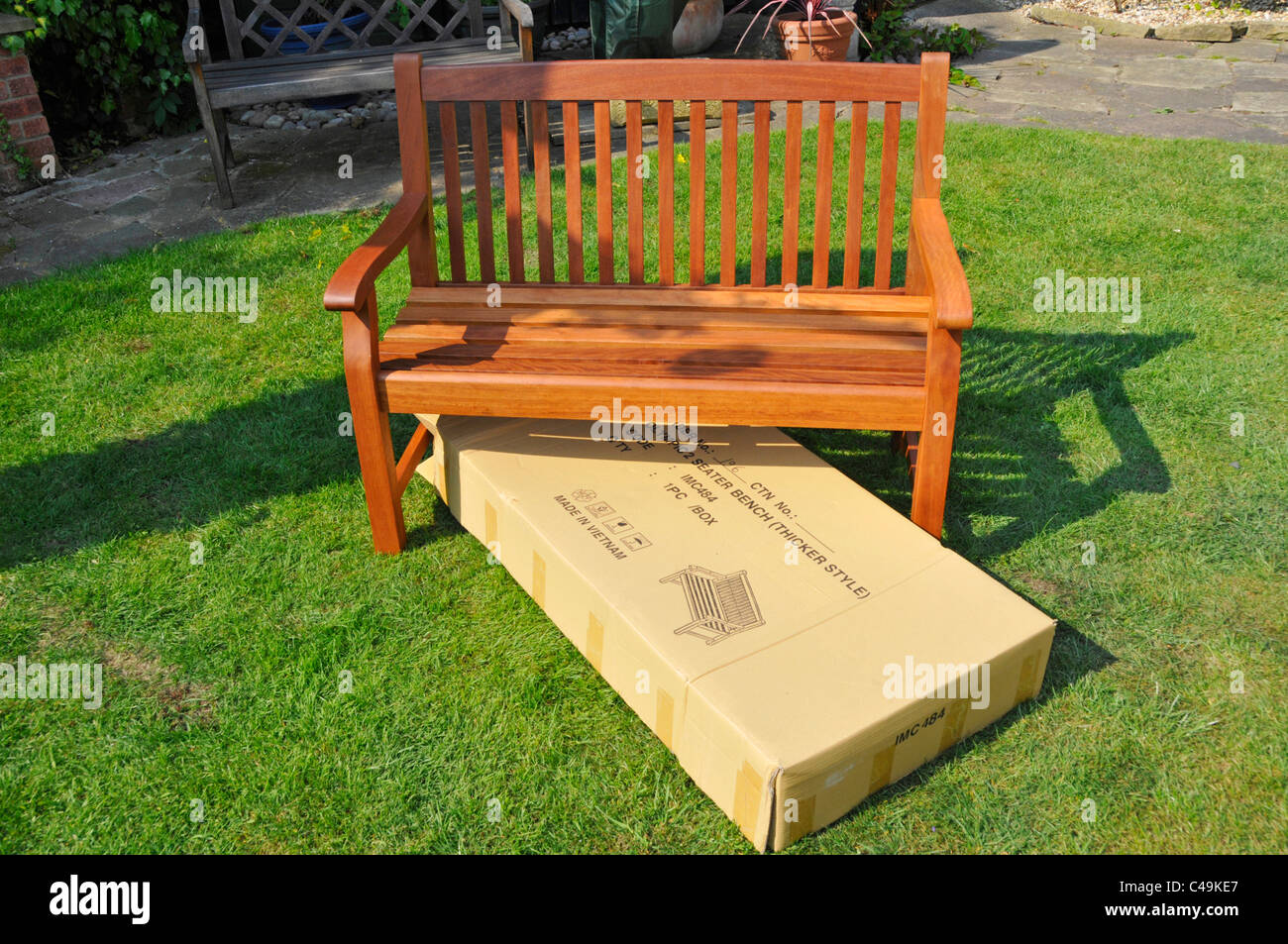 Imported self assembly hardwood garden seat and empty box with import markings Stock Photo