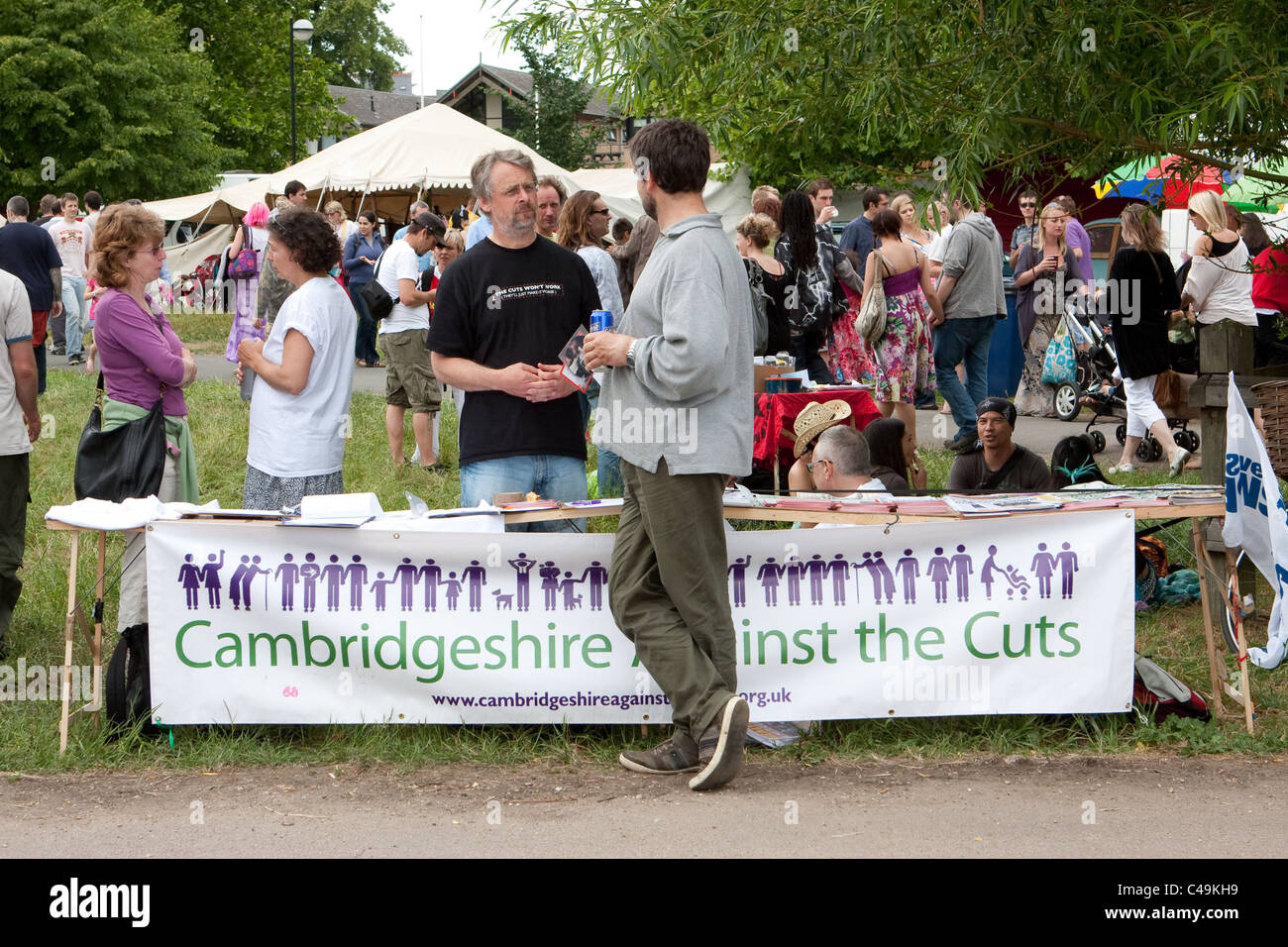 Stall of a campaign group against government cuts at the Cambridge Strawberry Fair in June 2011 - Stock Image