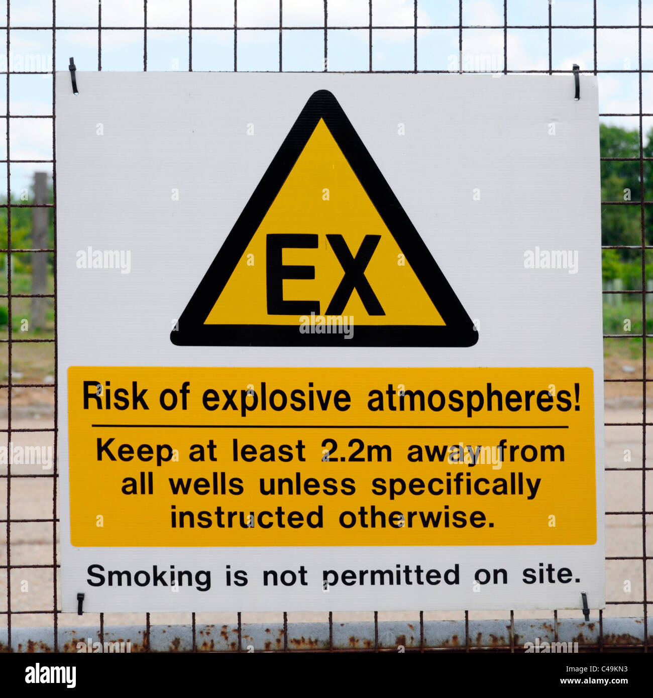 Explosive atmosphere warning signs on gates of closed landfill site - Stock Image