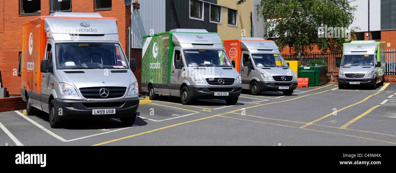 Ocado delivery vans parked at depot - Stock Image