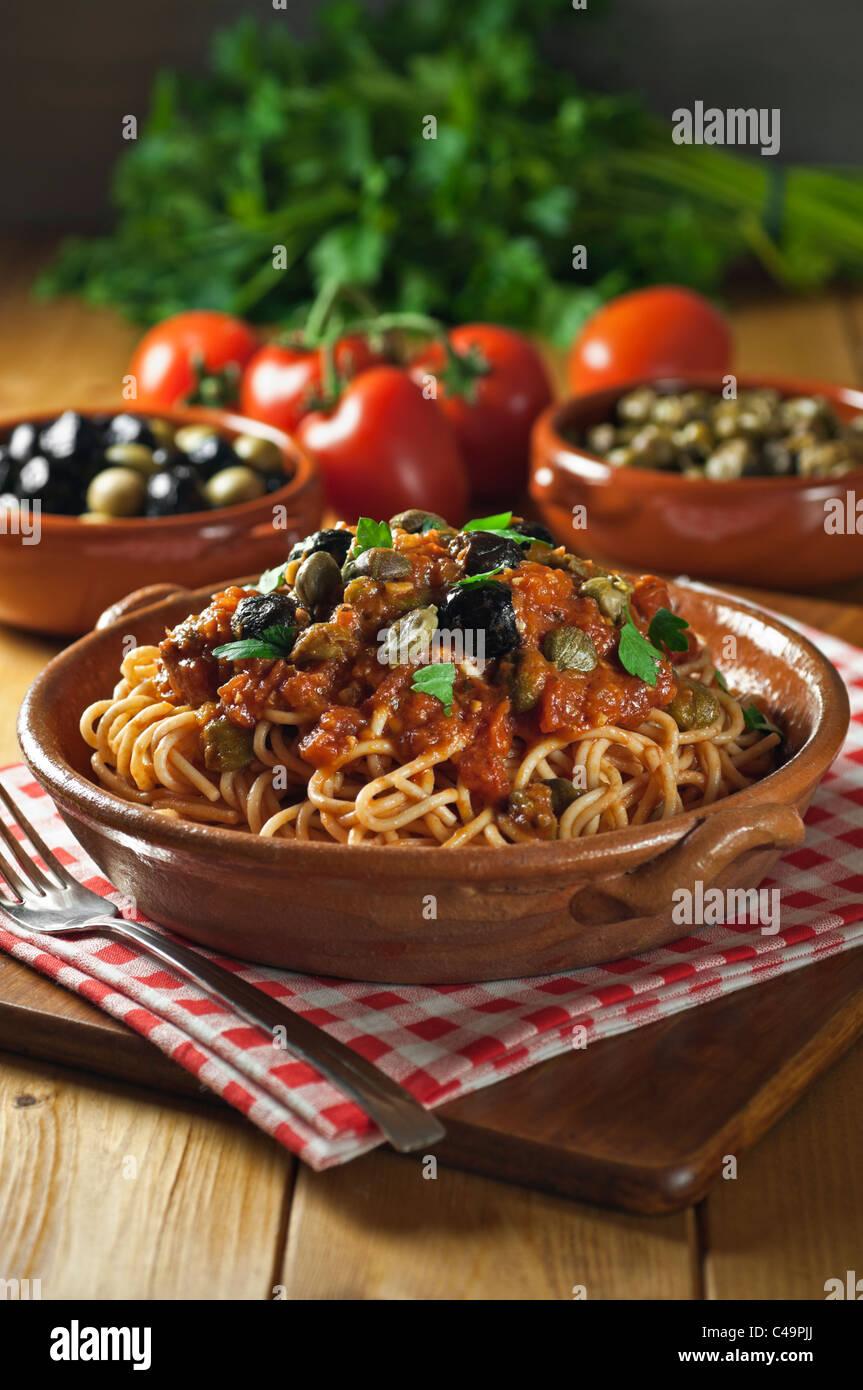 Spaghetti alla puttanesca Italian food Stock Photo