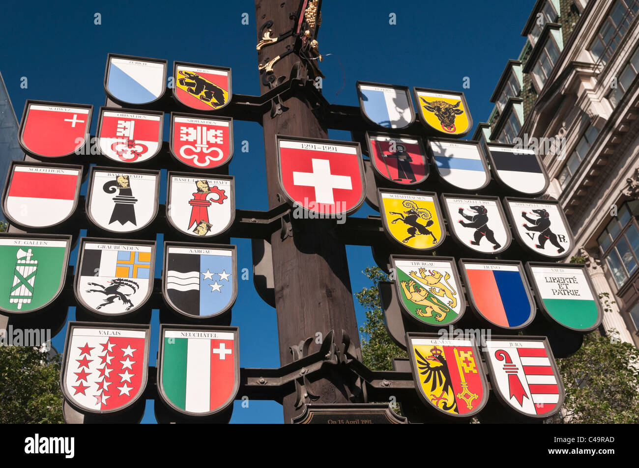 Cantonal tree sign of Swiss cantons at Swiss Court Leicester Square London UK - Stock Image