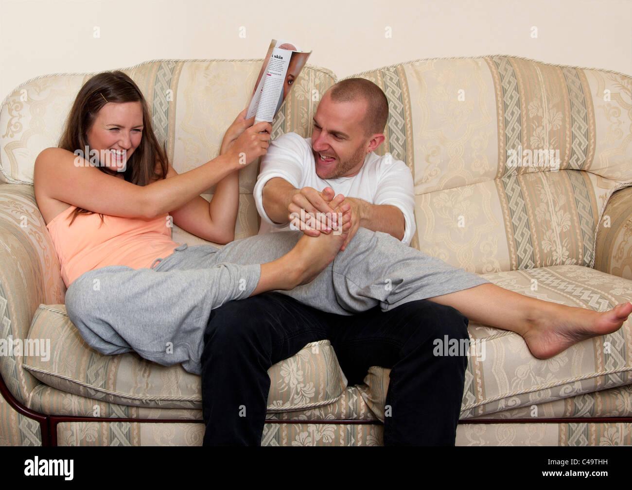 Tickling womens feet