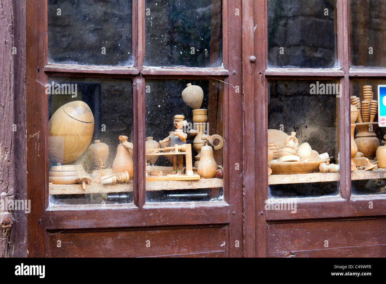 The dusty window of a craftsmans workshop in the village of St Cirq Lapopie, Lot, France, Europe - Stock Image