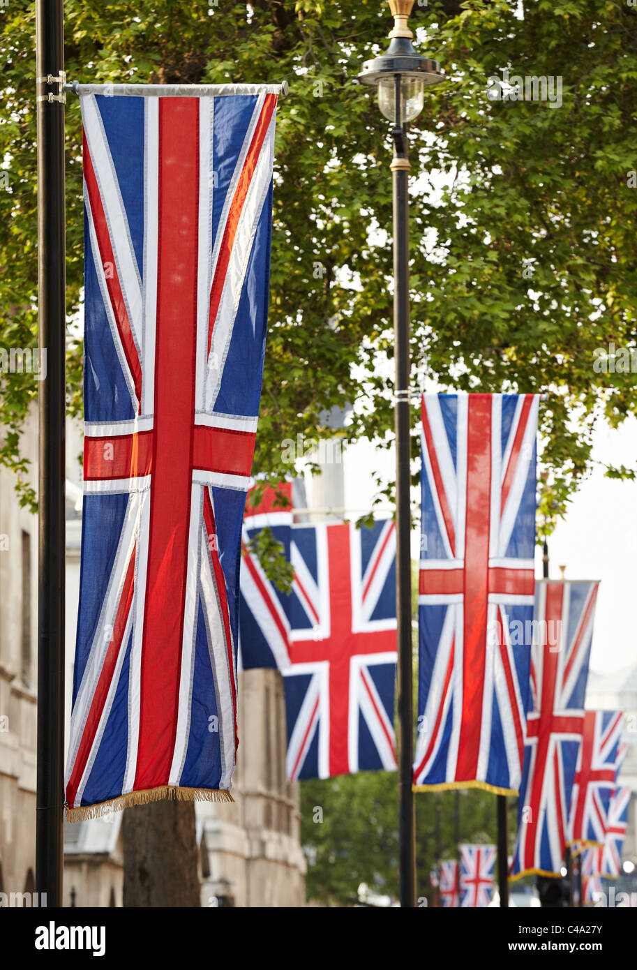Union Jack flags hanging in Whitehall London UK - Stock Image