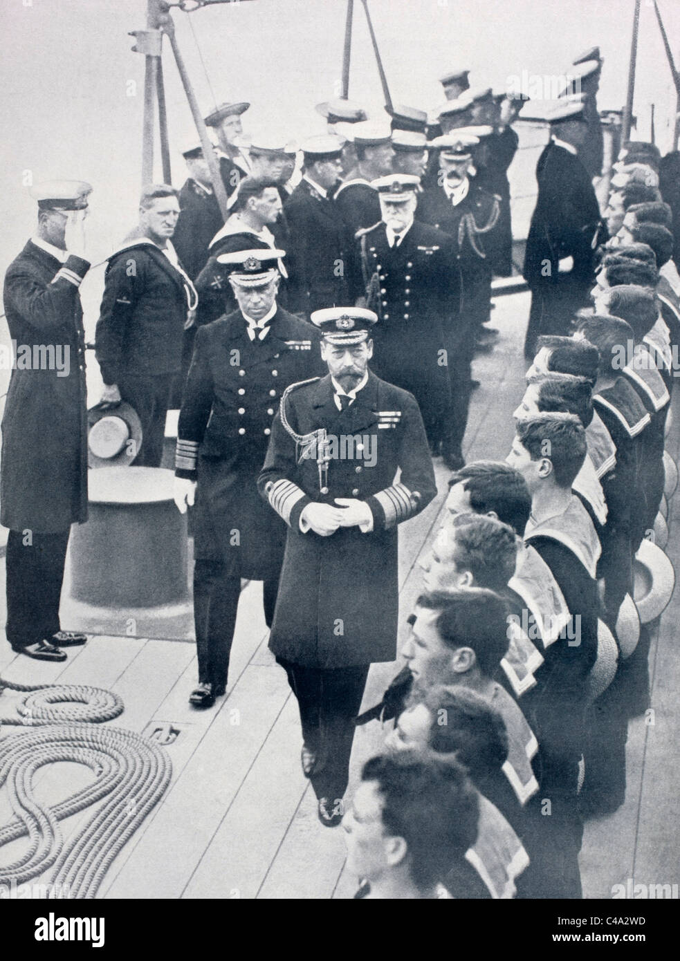 King George V of England reviewing the crew of the battleship Iron Duke in 1914. - Stock Image