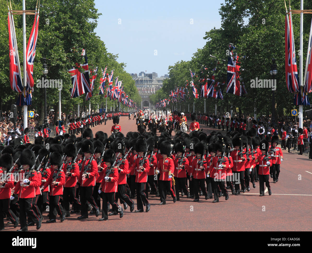 Procession in The Mall at Trooping of the Colour Ceremony with Grenadier guards in foreground. - Stock Image