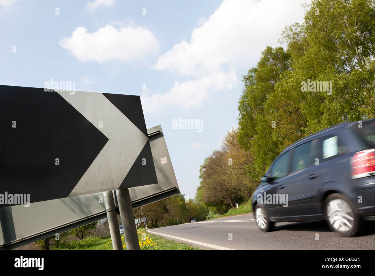 road warning sign 'Sharp deviation of route' - Stock Image