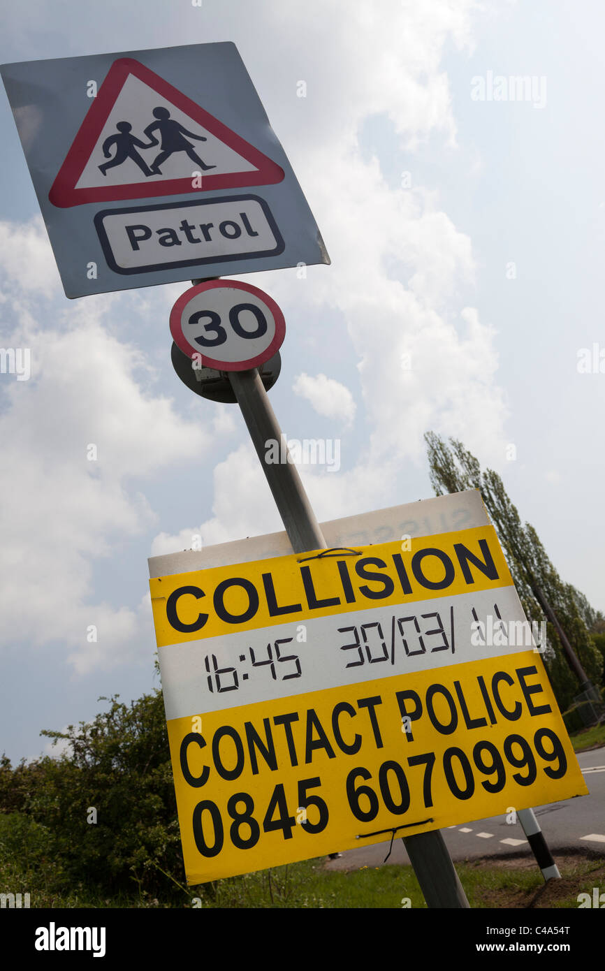 collision, contact police sign on school patrol road sign - Stock Image