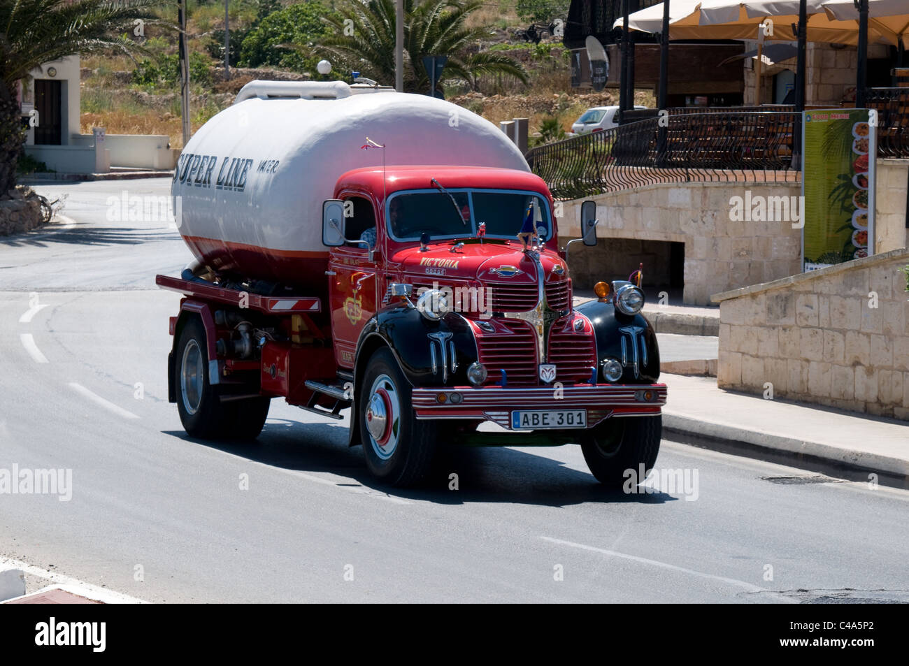 This 1940's Dodge lorry is still used in daily service as a water tanker,. Seen here in Mellieha bay,Malta - Stock Image