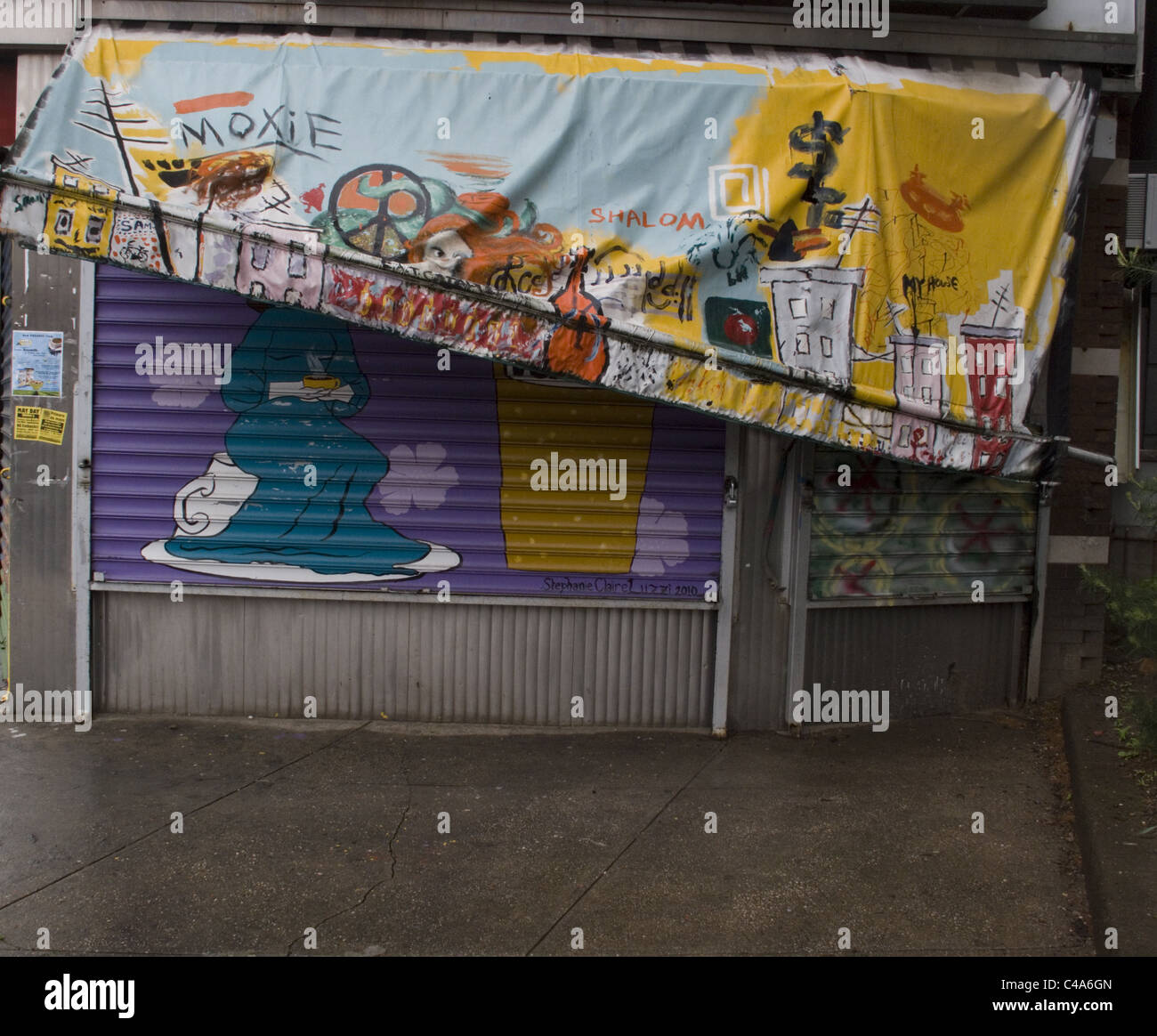 Damaged awning on a shuttered storefront in Brooklyn, NY. - Stock Image
