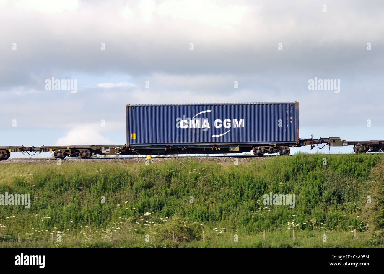 CMA CGM shipping container on train, UK - Stock Image